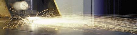 Sparks flying from a laser cutting steel